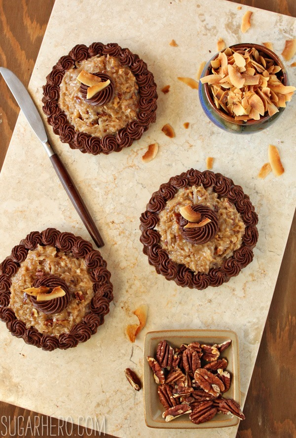 German Chocolate Brownie Tarts | SugarHero.com