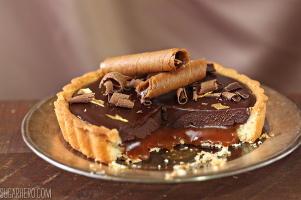 Four Fantastic Ways to Use Ganache: Salted Caramel Chocolate Tarts | From SugarHero.com